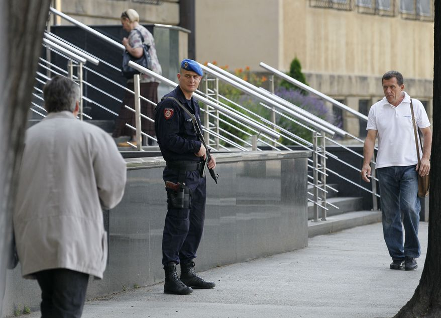 A member of the Serb Gendarmerie guards the entrance of the Special Court in Belgrade, Serbia, on May 31, 2011. As he awaited extradition to a U.N. tribunal, jailed war crimes suspect Ratko Mladic was allowed to visit the grave of his daughter, who committed suicide during Bosnia's war. (Associated Press)