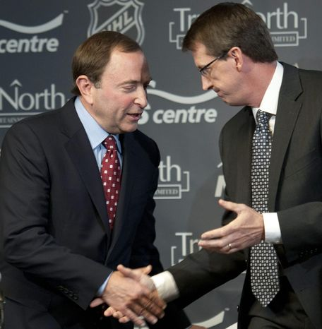 True North Sports and Entertainment chairman Mark Chipman, right, and NHL commissioner Gary Bettman shake hands after a news conference, Tuesday May 31, 2011, in Winnipeg, Manitoba, announcing that the Atlanta Thrashers are moving to Winnipeg. (AP Photo/The Canadian Press, David Lipnowski)