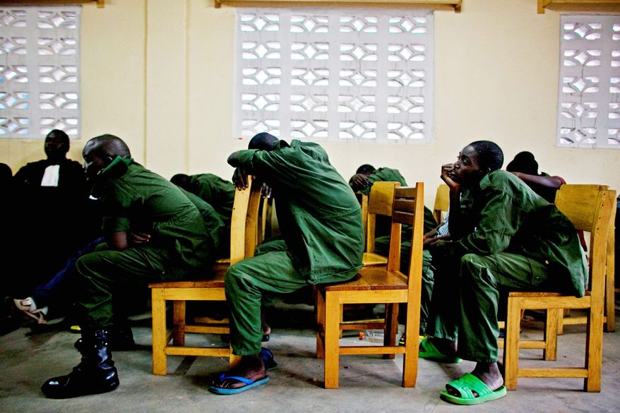 ASSOCIATED PRESS PHOTOGRAPHS Soldiers accused of rape and crimes against humanity sit through a military tribunal in the town of Baraka, Congo. A Congolese court sentenced an army colonel to 20 years in prison in the highest-profile sexual violence case ever tried in this nation, where thousands are brutally raped each year. The February trial held in a torridly hot makeshift courtroom marks the first time a commanding officer has been tried for such a crime.
