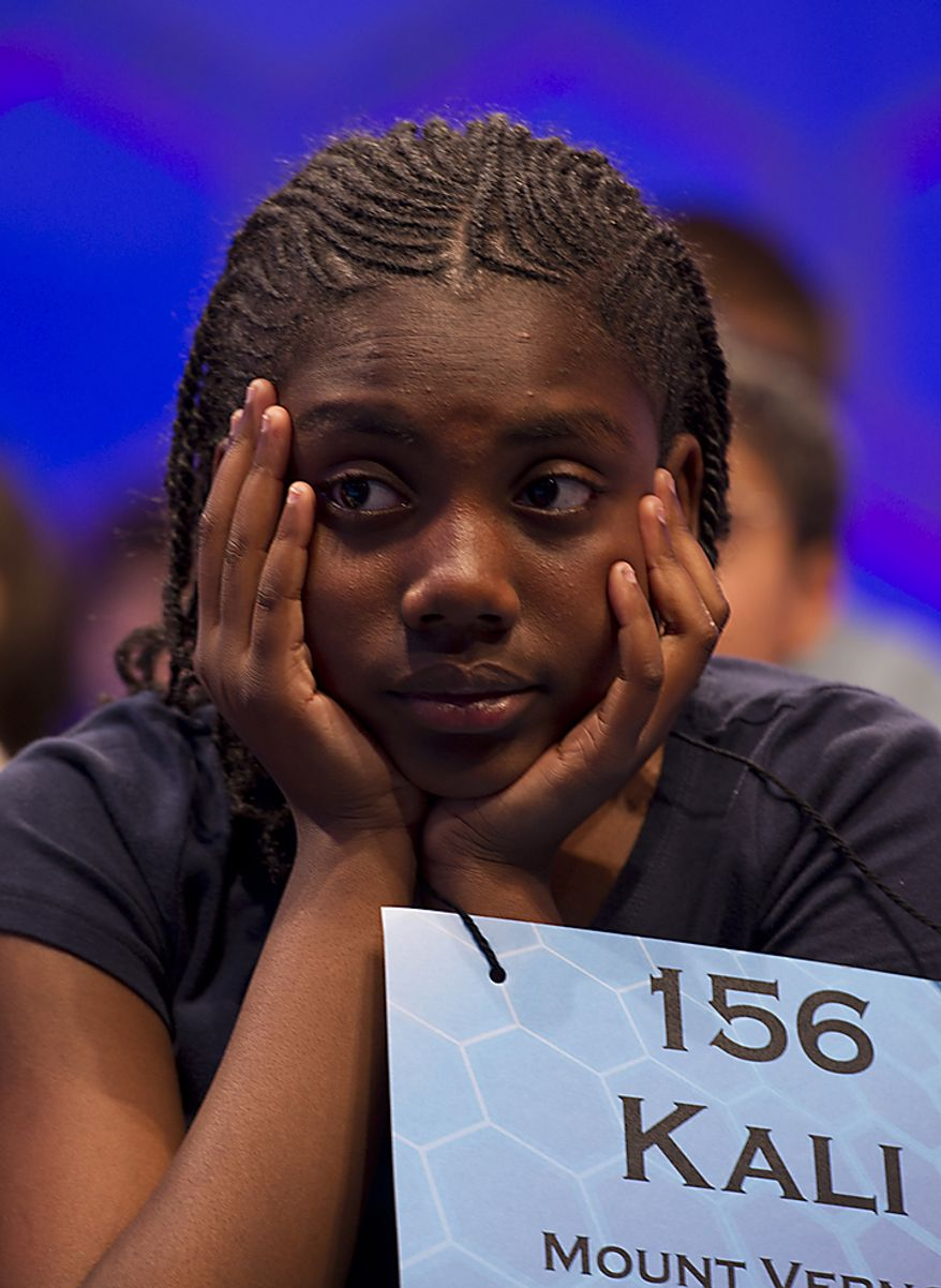 Eleven-year-old Kali Palmer of Mount Vernon, N.Y., looks bored waiting for the other spellers in Round Two of the Scripps Howard National Spelling Bee to get through their words on Wednesday, June 1, 2011. Two hundred and seventy-five spellers from around the country competed in the 2011 bee, which was held at the Gaylord National in Oxon Hill, Md. Spellers were not eliminated during Wednesday's rounds, but rather earned points towards competing in the semifinals, which will be held tomorrow. (Barbara L. Salisbury/The Washington Times)