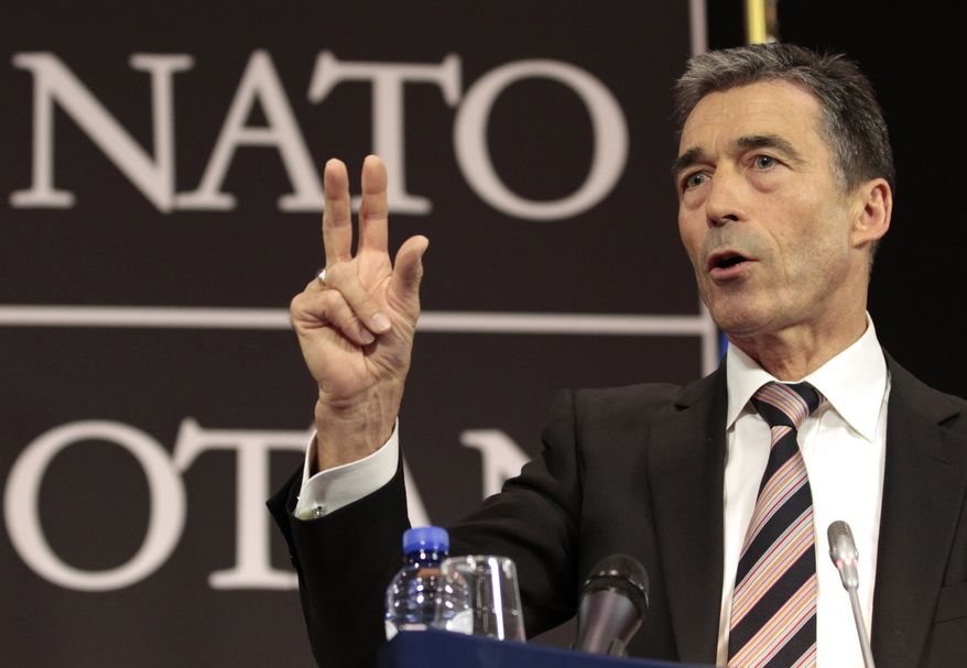 ** FILE ** NATO Secretary-General Anders Fogh Rasmussen speaks during a media conference at NATO headquarters in Brussels on Wednesday, May 4, 2011. (AP Photo/Yves Logghe, File)
