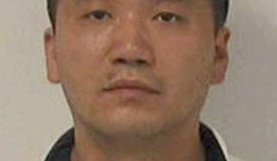 Bus driver Kin Yiu Cheung, 37, of Flushing, N.Y., is jailed on a $3,000 bond in connection with a deadly bus crash on Interstate 95 in Virginia on Tuesday, May 31, 2011. (AP Photo/Virginia State Police)
