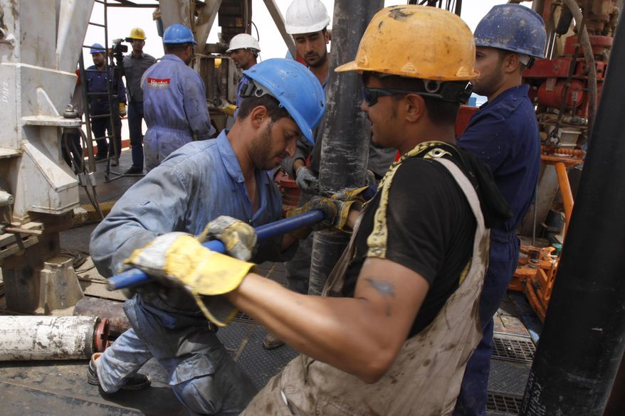 Oil workers work at Zubair oil field near Basra, 340 miles southeast of Baghdad, Iraq, Sunday, May 15, 2011. (AP Photo/Nabil al-Jourani) ** FILE **
