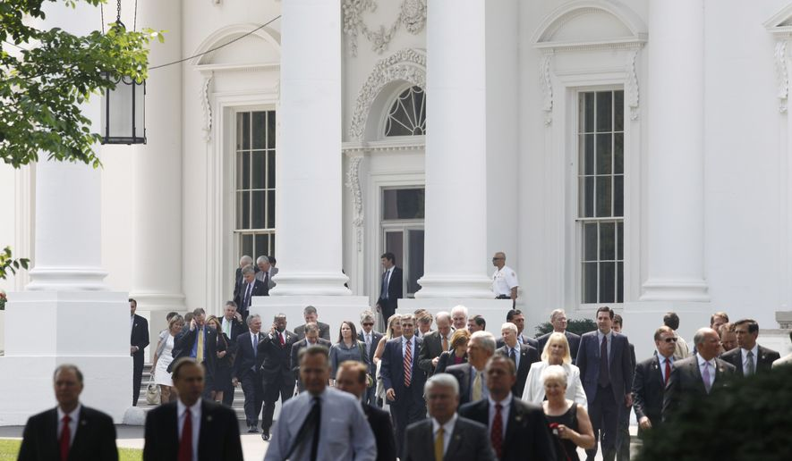 House Republicans leave the White House via the North Portico on Wednesday, June 1, 2011, after their meeting with President Obama on the debt ceiling. (AP Photo/Charles Dharapak)