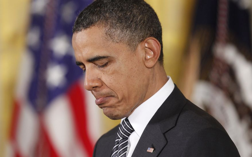 ** FILE ** President Obama pauses in the East Room of the White House in Washington on Monday, May 2, 2011, while speaking about the capture and killing of Osama bin Laden before awarding the Medal of Honor posthumously to U.S. Army Pvt. 1st Class Anthony T. Kaholohanohano and U.S. Army Pvt. 1st Class Henry Svehla for conspicuous gallantry during the Korean War. (AP Photo/Charles Dharapak, File)
