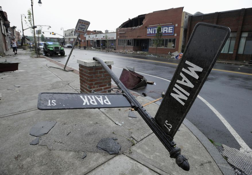 Storm damage is seen in downtown Springfield, Mass., Wednesday, June 1, 2011. An apparent tornado struck the downtown of one of the state's largest cities on Wednesday afternoon, scattering debris, toppling trees and frightening workers and residents. At least four have been reported dead. (AP Photo/Jessica Hill)