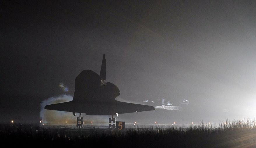 The space shuttle Endeavour touches down on Runway 15 at the Kennedy Space Center at Cape Canaveral, Fla., on Wednesday, June 1, 2011, after completing her final flight. Endeavour and her crew of six astronauts wrapped up a 16-day mission to the International Space Station. (AP Photo/John Raoux)