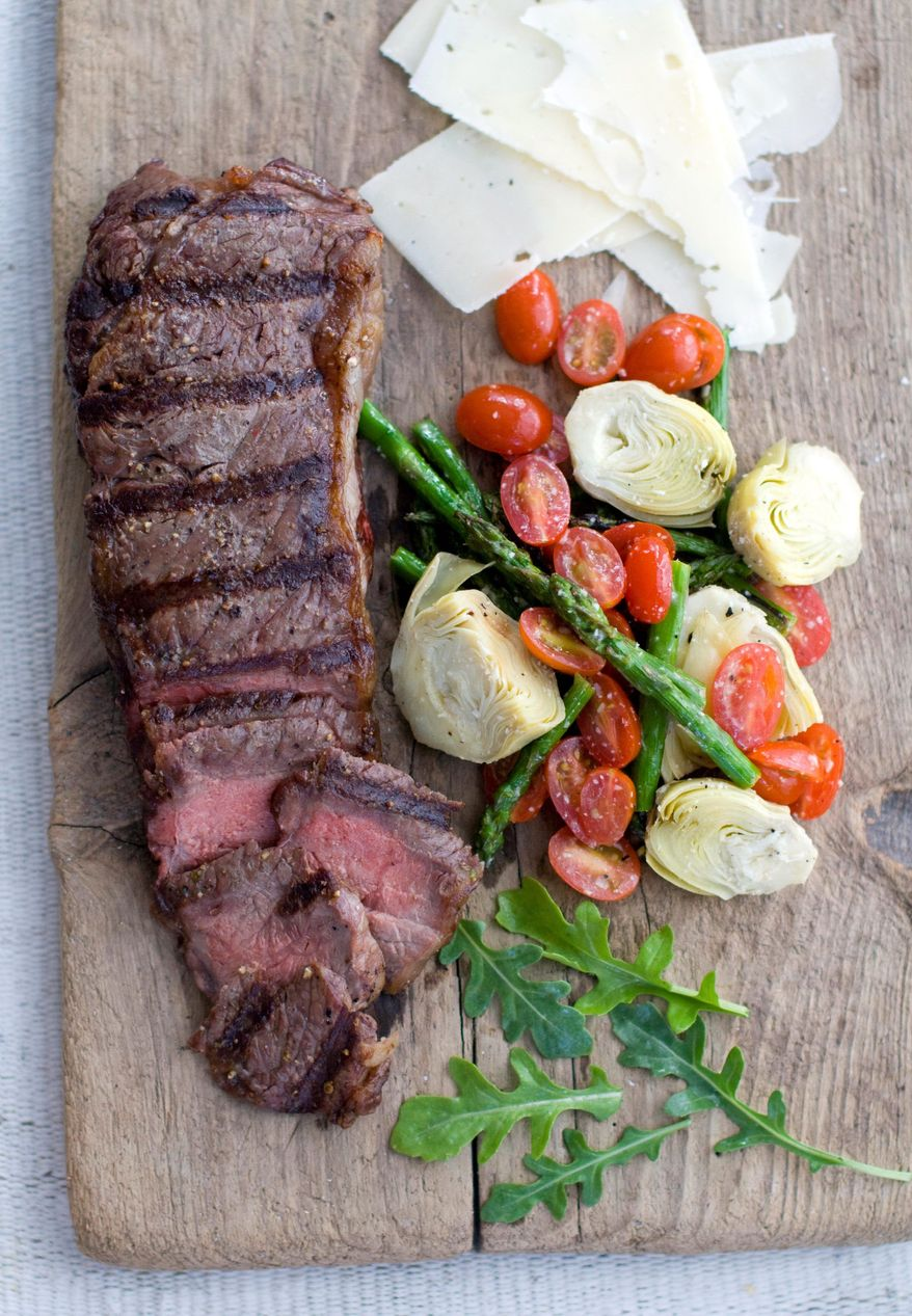 A spring vegetable salad and a grilled steak are ready for eating. Portions of the salad can be placed on the grill. (Associated Press)