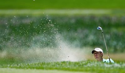 DREW ANGERER/THE WASHINGTON TIMES Chris McCartin of Arlington shoots out from a green-side bunker during the first round of the Nationwide Tour Prince George's County Open in College Park. McCartin carded a 3-over 74 on the University of Maryland Golf Course.
