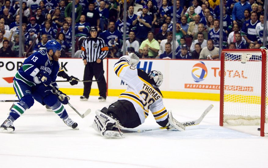 ASSOCIATED PRESS Vancouver left wing Raffi Torres slipped the puck past Boston goalie Tim Thomas with 18.5 seconds left to play for the game's only score in the Canucks' win in Game 1 of the Stanley Cup finals Wednesday. Game 2 of the best-of-seven series is Saturday in Vancouver.