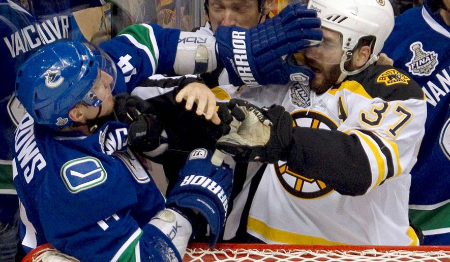 ASSOCIATED PRESS The NHL determined it could not prove whether Vancouver's Alex Burrows (left) bit the finger of Boston's Patrice Bergeron during Wednesday's Game 1.