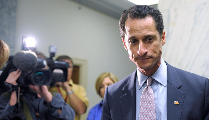 Cameras roll Thursday as Rep. Anthony D. Weiner waits for an elevator on Capitol Hill. Democrats are mum about the lewd photo sent to a coed on his Twitter account, but privately they're fuming over the distraction from political debate. (Associated Press)