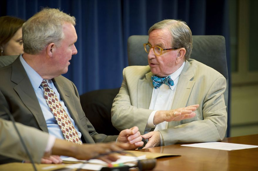 ROD LAMKEY JR./THE WASHINGTON TIMES  Human Services Committee Chairman Jim Graham confers with D.C. Council members about the nomination  of Neil A. Stanley as director  of the Department of Youth Rehabilitation Services.
