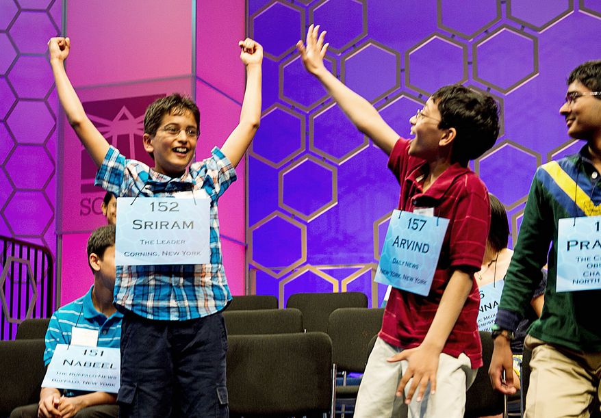 Photographs by Barbara L. Salisbury/The Washington Times Sriram Hathwar and Arvind Mahankali, both 11, celebrate Thursday after both New York spellers were named finalists in the 2011 Scripps National Spelling Bee, held at the Gaylord National Resort at National Harbor in Oxon Hill. They were among the 13 finalists who were set to battle Thursday night for the spelling crown.