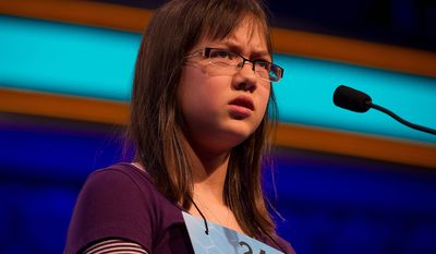 Laura Newcombe, 12, of Toronto, Ontario, Canada makes a face while spelling a word at the 2011 Scripps National Spelling Bee semifinals on Thursday, June 2, 2011 at the Gaylord National in Oxon Hill, Md. She is one of 13 spellers who advanced to tonight's final round. The winner will receive $30,000. (Barbara L. Salisbury/The Washington Times)