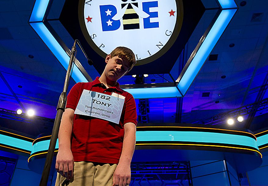 """Thirteen-year-old Tony Incorvati of Uniontown, Ohio, hangs his head after missing the word """"syringadenous"""" during the semifinals of the 2011 Scripps National Spelling Bee on Thursday, June 2, 2011 at the Gaylord National in Oxon Hill, Md. The finals will be broadcast live this evening on ESPN, and the winner will receive $30,000. (Barbara L. Salisbury/The Washington Times)"""
