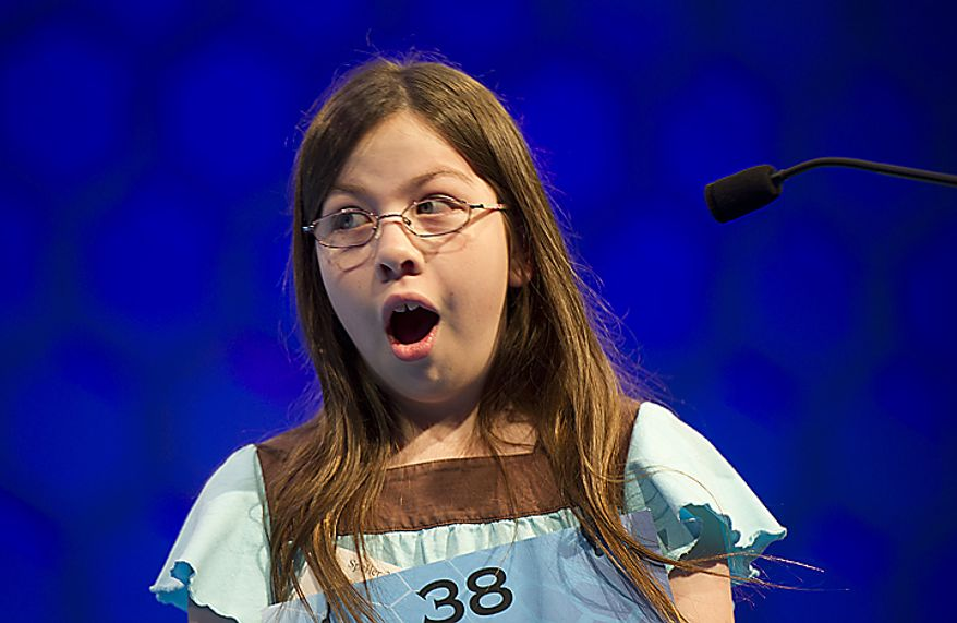 """Grace Remmer, 12, of St. Augustine, Fla., looks surprised after correctly spelling """"Liptauer"""" during Round Six of the semifinals round of the 2011 Scripps National Spelling Bee on Thursday, June 2, 2011 at the Gaylord National in Oxon Hill, Md. Forty-one spellers competed in the semifinals, and only 13 will advance to the finals, which will be broadcast live this evening on ESPN. Grace missed """"casquetel"""" in Round Seven, so she did not advance. (Barbara L. Salisbury/The Washington Times)"""