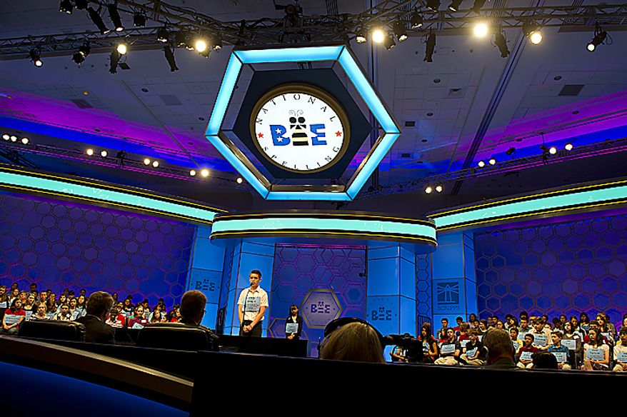 "Jesus Lara, 13, of Durham, N.C., spells ""quagmiry"" during Round Two of the 2011 Scripps Howard National Spelling Bee Wednesday, June 1, 2011. Two hundred and seventy-five spellers from around the country competed in rounds two and three of the bee at the Gaylord National in Oxon Hill, Md. Spellers were not eliminated during Wednesday's rounds, but rather earned points towards competing in the semifinals, which will be held tomorrow. (Barbara L. Salisbury/The Washington Times)"