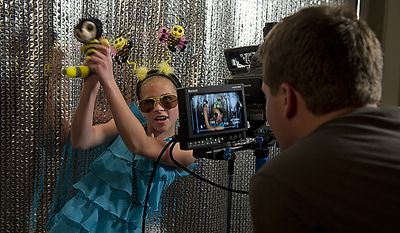 Eleven-year-old Paige Myroth of Rochelle, Illinois, dances with a stuffed bumble bee while wearing a bumble bee headband for an ESPN cameraman who is recording an intro piece for the televised version of the 2011 Scripps Howard Spelling Bee. Paige was among the 275 spellerswho competed in rounds two and three of the bee on Wednesday, June 1, 2011 at the Gaylord National in Oxon Hill, Md. Spellers were not eliminated during Wednesday's rounds, but rather earned points towards competing in the semifinals, which will be held Thursday. Only 50 spellers will advance. (Barbara L. Salisbury/The Washington Times)