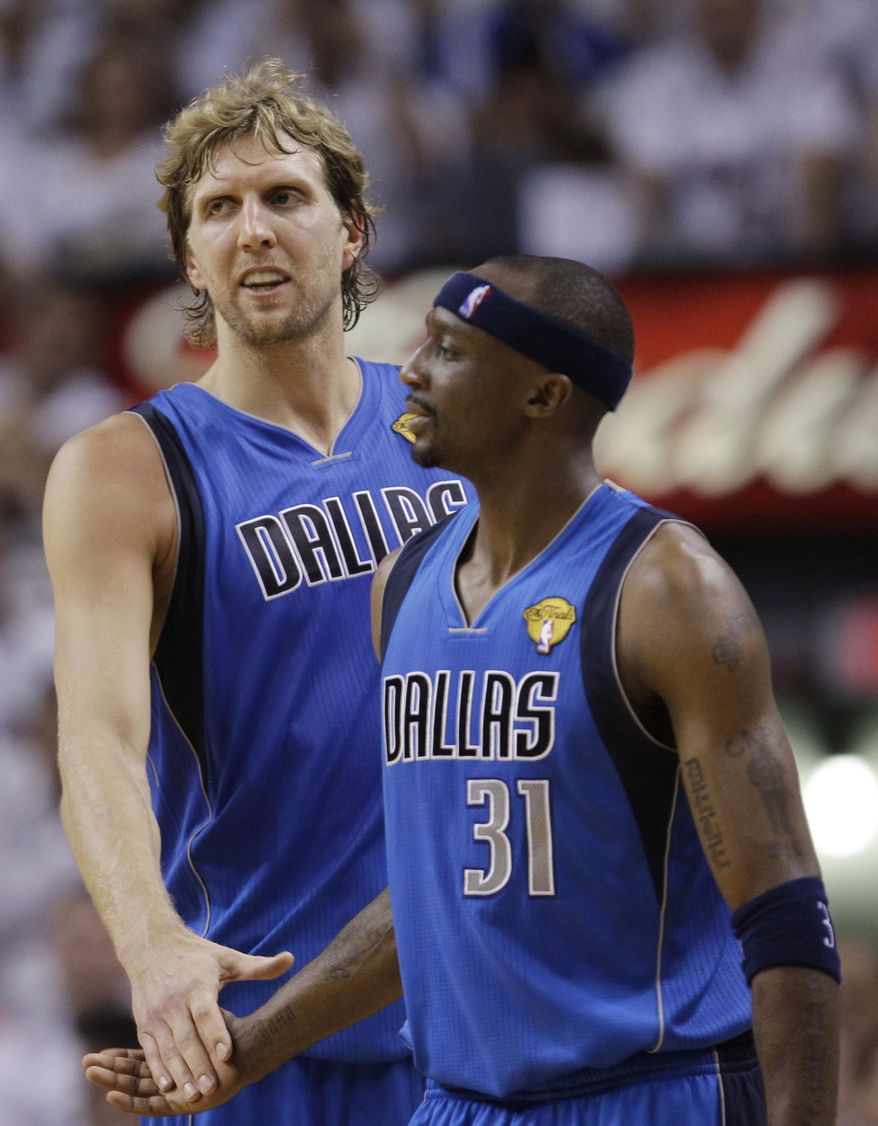 Dallas Mavericks' Jason Terry (31) and Dirk Nowitzki shake hands during the first half of Game 2 of the NBA Finals basketball game against the Miami Heat, Thursday, June 2, 2011, in Miami. Nowitzki made the winning layup to beat the Heat 95-93 and cap a stunning comeback. (AP Photo/David J. Phillip)