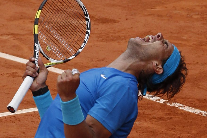 Rafael Nadal of Spain celebrates defeating Andy Murray of Britain in the semi final match of the French Open tennis tournament in Roland Garros stadium in Paris, Friday June 3, 2011. Nadal won in three sets, 6-4, 7-5, 6-4. (AP Photo/Christophe Ena)