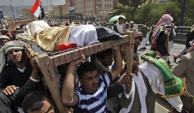 Relatives and friends of tribesmen loyal to Sheik Sadeq al-Ahmar, the head of the powerful Hashid tribe, who were killed in clashes with Yemeni security forces carry their bodies during their funeral procession in Sanaa, Yemen, on June 3, 2011. (Associated Press)