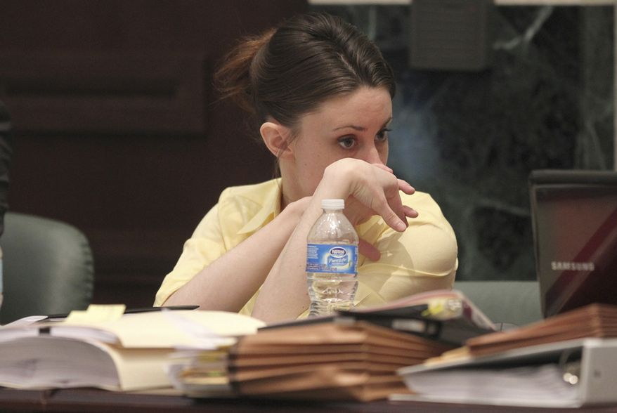 Casey Anthony is shown in court during her trial at the Orange County Courthouse, Friday, June 3, 2011, in Orlando, Fla. Anthony, 25, is charged with killing her daughter Caylee in the summer of 2008. (AP Photo/Red Huber, Pool)