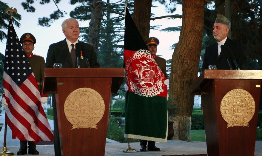 U.S. Defense Secretary Robert Gates, left, speaks during a joint news conference with Afghan President Hamid Karzai, right, at the presidential palace in Kabul, Afghanistan, Saturday, June 4, 2011. (AP Photo/Musadeq Sadeq)