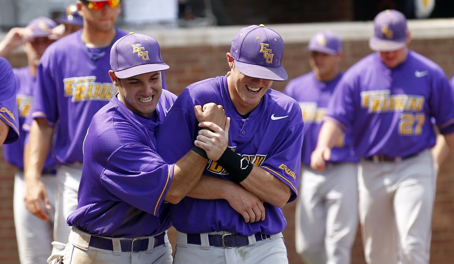 East Carolina's Ben Fultz, left, and Mike Ussery (2) celebrate the 6-1 victory over Navy in an NCAA regional baseball tournament game, Saturday, June 4, 2011 in Charlottesville, Va. Navy was eliminated from NCAA tournament competition with the loss. (AP Photo/Andrew Shurtleff)