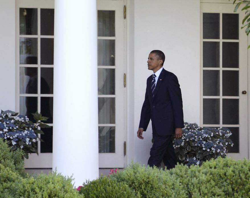 President Barack Obama walks to the Oval Office of the White House in Washington, Friday, June 3, 2011, as he returned from Ohio. (AP Photo/Carolyn Kaster)