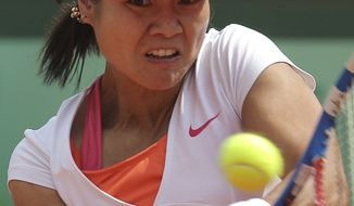 China's Li Na returns the ball to Italy's Francesca Schiavone during their women's final match for the French Open tennis tournament at the Roland Garros stadium, Saturday, June 4, 2011, in Paris. (AP Photo/Michel Euler)