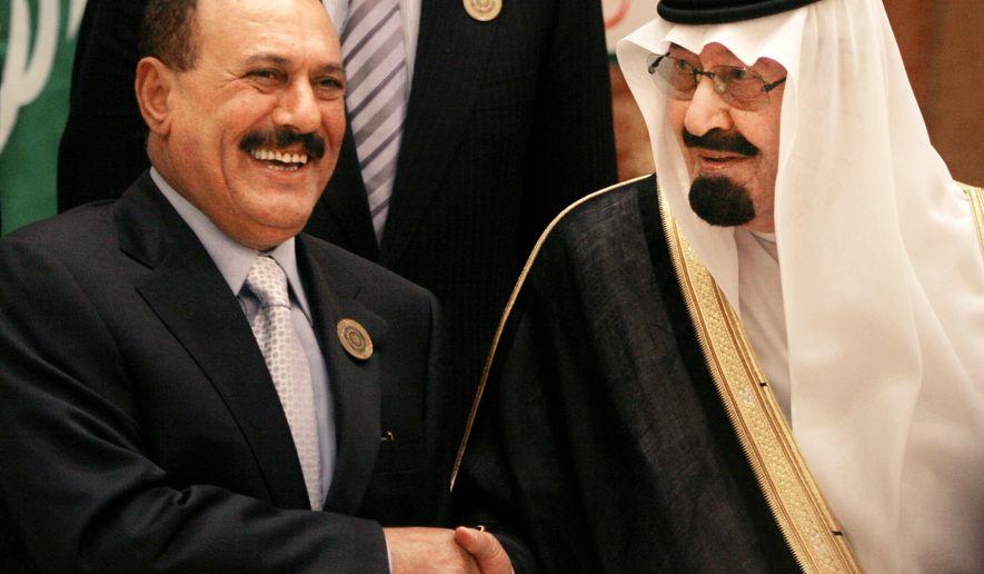 ** FILE ** In this March 27, 2007, file photo, Saudi King Abdullah bin Abd al-Aziz, right, shakes hands with Yemeni President Ali Abdullah Saleh before the Arab summit in Riyadh, Saudi Arabia. (AP Photo/Amr Nabil, File)
