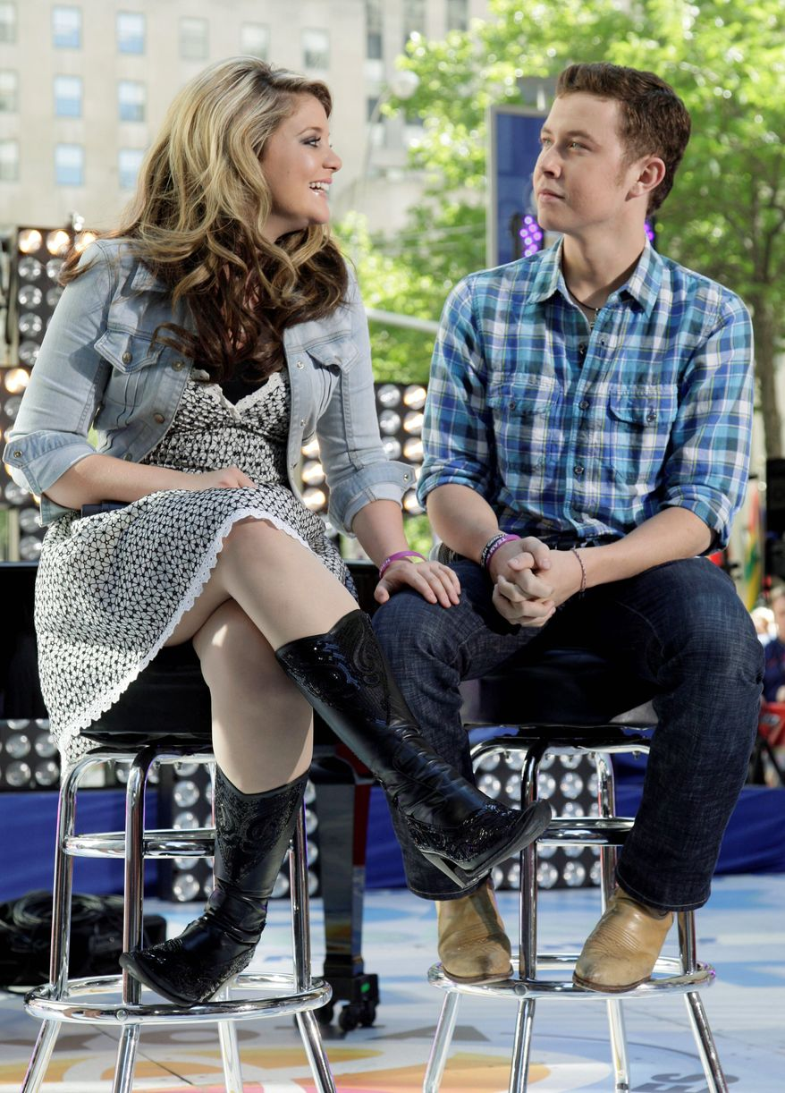 """ASSOCIATED PRESS """"American Idol"""" winner Scotty McCreery and runner-up Lauren Alaina appear Thursday on the """"Today"""" show in New York. The teenagers have been doing press together while pursuing careers in country music after the show's May 25 season finale."""
