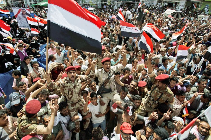 ASSOCIATED PRESS Soldiers chant slogans and wave their national flag in Sanaa, Yemen, on Sunday as they celebrate with demonstrators the departure of President Ali Abdullah Saleh. Thousands of celebrants jammed the capital after the country's authoritarian leader flew to Saudi Arabia to receive medical treatment for wounds he suffered in a rocket attack.