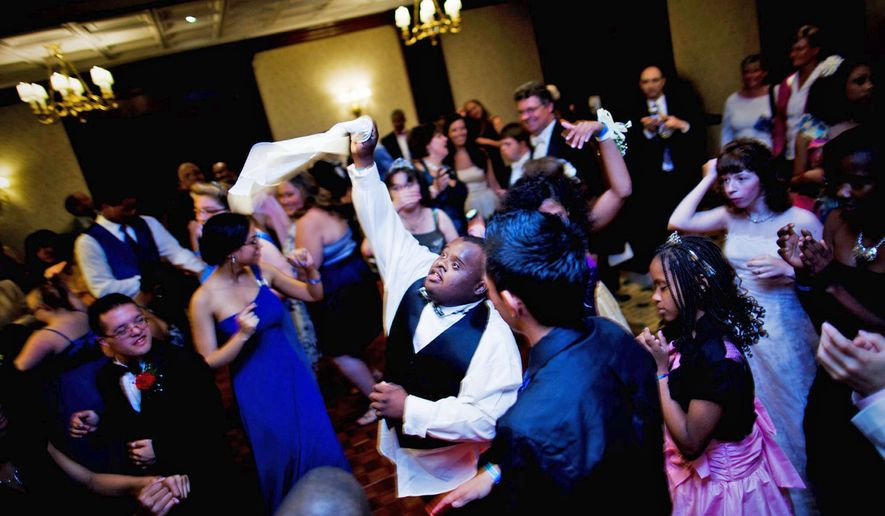 Students at the Cinderella Ball let loose on the dance floor with friends and family at the Willard Intercontinental Hotel on Sunday. The event was hosted by the Woodbridge, Va.-based House, which offers lifestyle resources while helping its students learn life skills and work on athletics and academics. (Pratik Shah/The Washington Times)