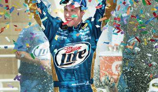 ASSOCIATED PRESS Brad Keselowski celebrates after winning the STP 400 at Kansas Speedway, his second career Sprint Cup victory. Keselowski also won at Talladega n 2009.