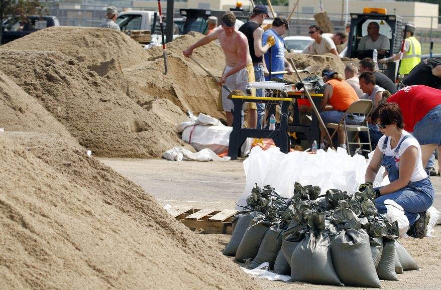 Workers fill sandbags at Dakota Valley High School on Saturday, June 4, 2011, in McCook Lake, S.D. (AP Photo/The Sioux City Journal, Jim Lee)