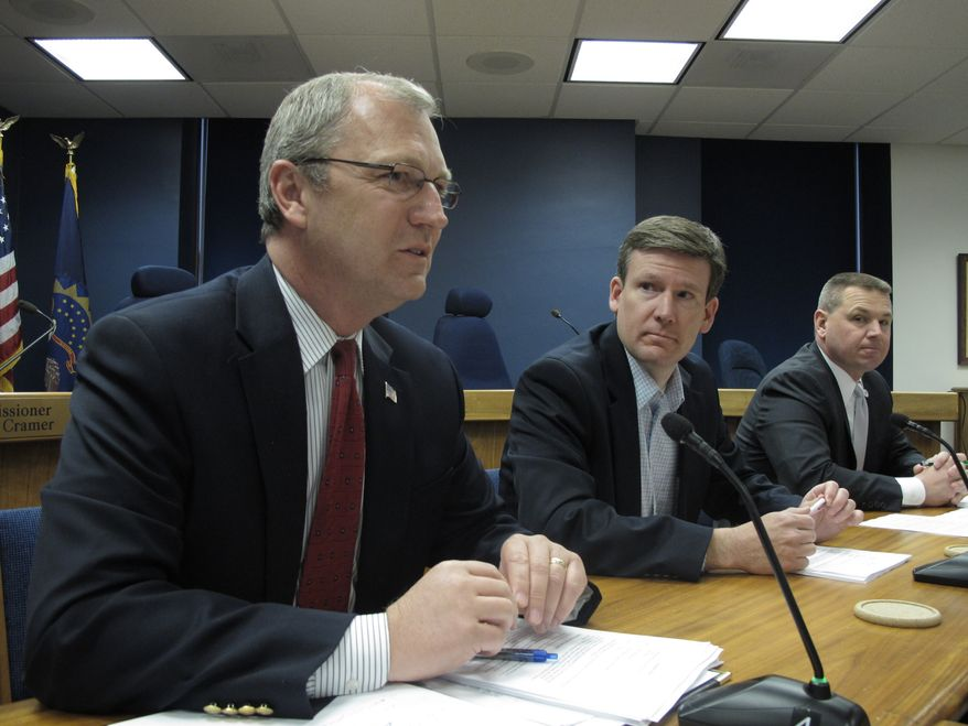 North Dakota Public Service Commissioner Kevin Cramer (left) speaks as Commissioners Tony Clark (center) and Brian Kalk listen on Friday, May 13, 2011, at the North Dakota Capitol in Bismarck, N.D., during a meeting to discuss an oil spill by TransCanada Corp.'s Keystone oil pipeline in southeastern North Dakota the week before. (AP Photo/Dale Wetzel)