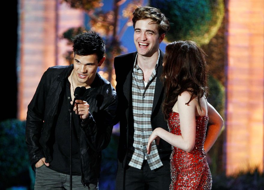 """Taylor Lautner (left), Robert Pattinson and Kristen Stewart of """"The Twilight Saga: Eclipse"""" share the stage at the MTV Movie Awards. (Associated Press)"""