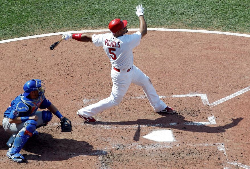 St. Louis first baseman Albert Pujols slugged four home runs in a three-game sweep of the Chicago Cubs, including game-winning blasts Saturday and Sunday. (Associated Press)
