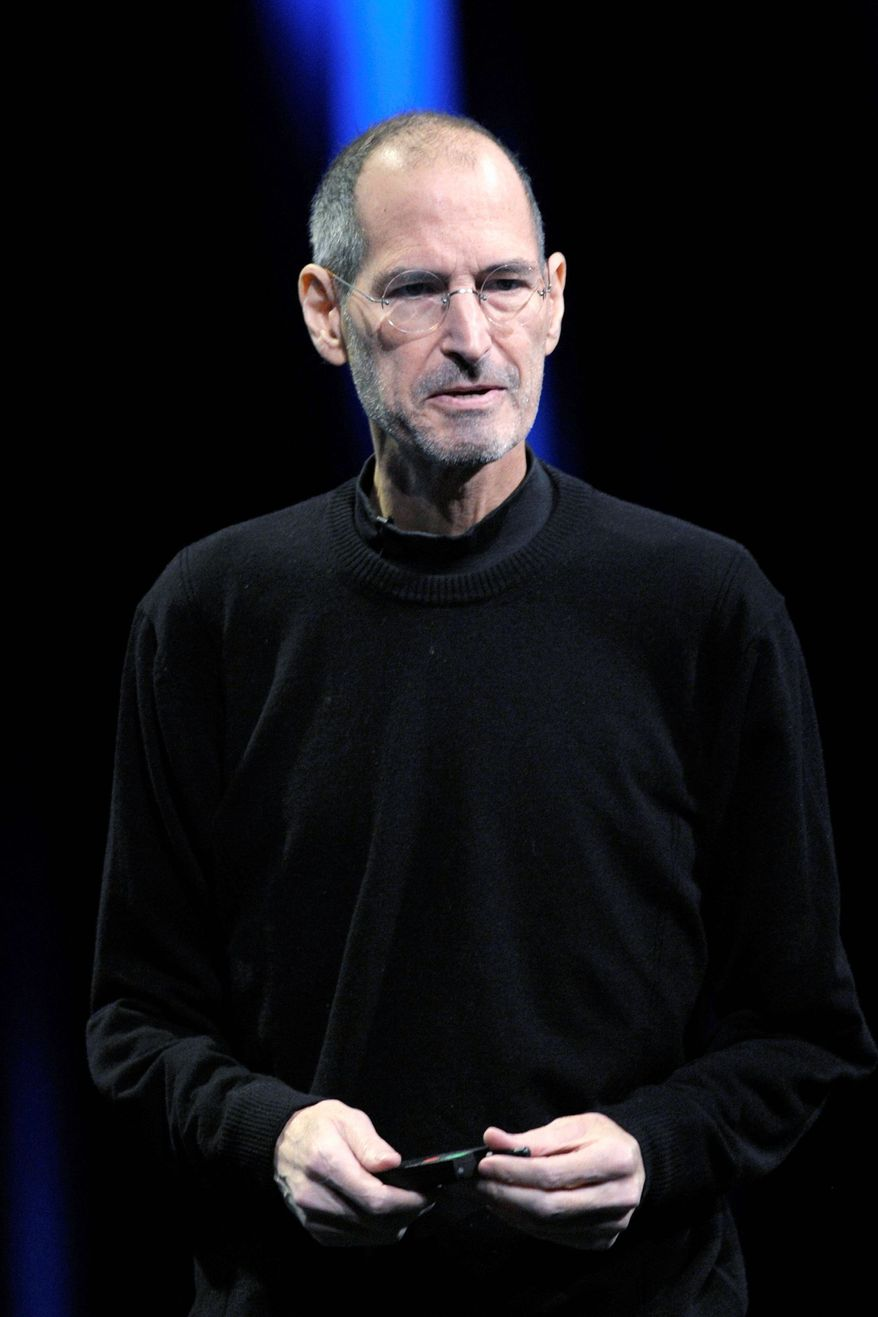 ASSOCIATED PRESS Apple CEO Steve Jobs tells the firm's developers conference on Monday the new iCloud system enables users to share songs and data among devices.