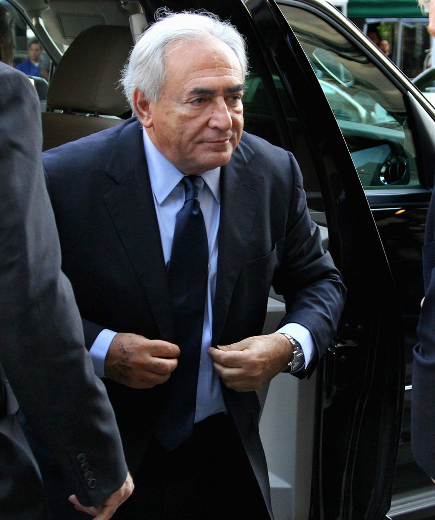 Former International Monetary Fund leader Dominique Strauss-Kahn arrives at the Manhattan Criminal Courts building on Monday for his arraignment proceedings on charges of sexually assaulting a Manhattan hotel maid. The French economist and diplomat has said he is not guilty. (Associated Press)