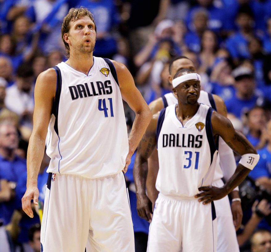 ASSOCIATED PRESS Dirk Nowitzki (41) is averaging 28.3 points for Dallas through Game 3 of the finals, but offense has been hard to come by for Jason Terry (31) and the rest of the Mavericks.