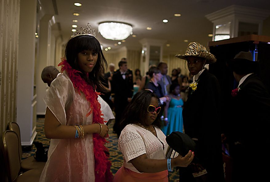 Students at the Cinderella Ball try on comical sunglasses and hats before entering a photo booth at The Willard Intercontinental Hotel in Washington, D.C. on Sunday, June 5, 2011. This was the sixth annual Cinderella Ball, where students with life-threatening illnesses or disabilities came together to celebrate. (Pratik Shah/The Washington Times)