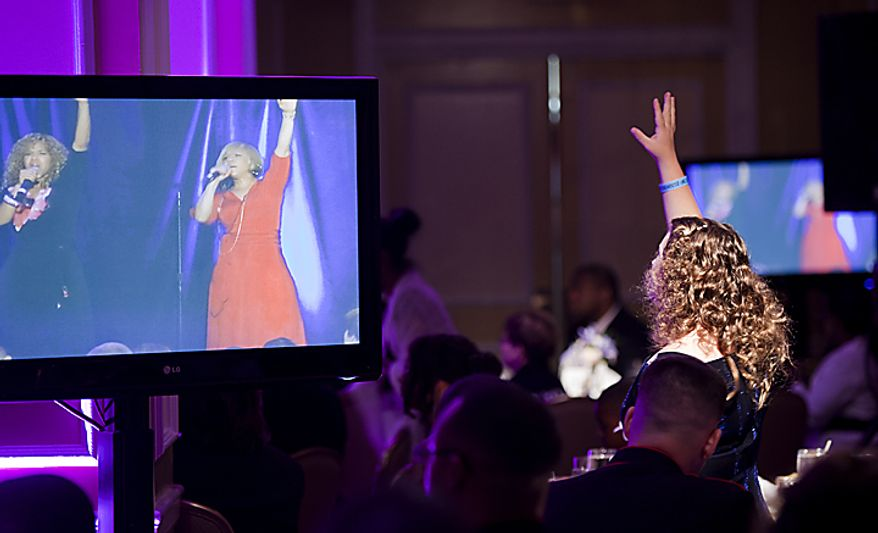 Students dance with Grammy-award winning music duo Mary Mary at the Cinderella Ball at The Willard Intercontinental Hotel in Washington, D.C. on Sunday, June 5, 2011. This was the sixth annual Cinderella Ball, where students with life-threatening illnesses or disabilities came together to celebrate. (Pratik Shah/The Washington Times)