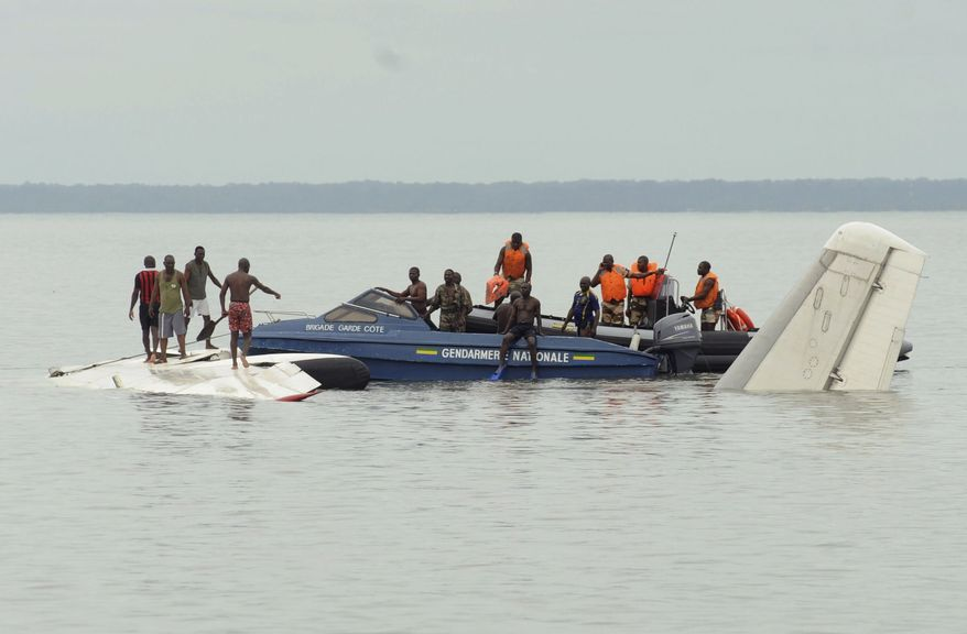 Military police investigate a partially submerged DHL cargo plane, which crashed just off the coast of Libreville, Gabon, on June 6, 2011. (Associated Press)
