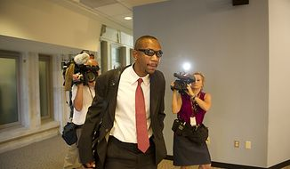 Sulaimon Brown arrives on June 6, 2011, to testify before a D.C. Council committee at the Wilson Building in Washington about allegations that he was paid off by Mayor Vincent C. Gray, then promised a government job. (Rod Lamkey Jr./The Washington Times)