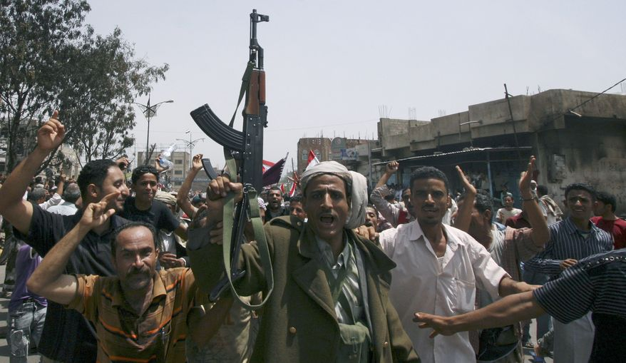 A Yemeni tribesman holds up his rifle on June 5, 2011, while shouting slogans with anti-government protesters in Taiz, Yemen, as they celebrate President Ali Abdullah Saleh's departure to Saudi Arabia. (Associated Press)