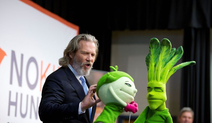 "Actor Jeff Bridges has some fun with ""Super Sprowtz"" during a rally to launch the Share Our Strength No Kid Hungry campaign at Bancroft Elementary in Arlington on Tuesday. (Rod Lamkey Jr./The Washington Times)"