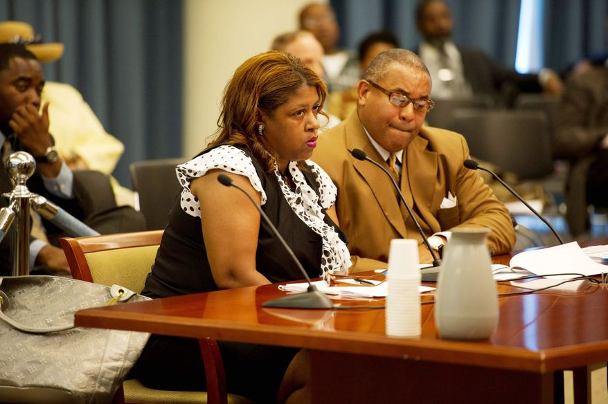ROD LAMKEY JR./THE WASHINGTON TIMES Accompanied by her attorney, A. Scott Bolden, Cherita Whiting testifies before the Government Operations Committee on Monday. She claimed she denied her felony conviction on a March 18, 2010, application for the job with D.C. Council member Phil Mendelson because she thought a 10-year grace period for disclosing prior felonies had expired.